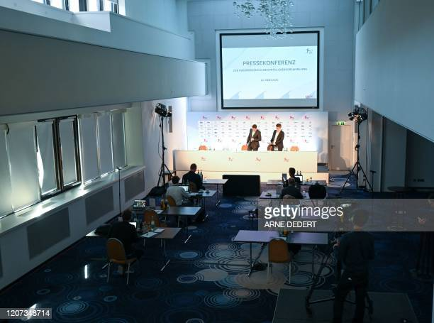 Chief Executive Officer of the German Football League Christian Seifert and Christian Pfenning DFL spokesman arrive to address a press conference...