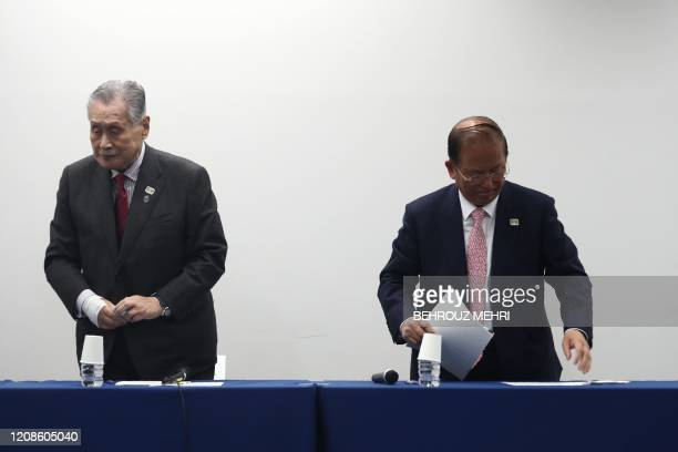 Chief executive officer of the Tokyo 2020 Olympics Toshiro Muto and Tokyo 2020 president Yoshiro Mori leave following their press conference in Tokyo...