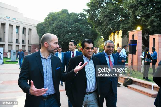 Chief Executive Officer of Uber Dara Khosrowshahi and Amitabh Kant CEO of the Indian government thinktank NITI Aayog walk in for a conference on...