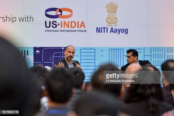Chief Executive Officer of Uber Dara Khosrowshahi speaks as Amitabh Kant CEO of the Indian government thinktank NITI Aayog looks on at a conference...