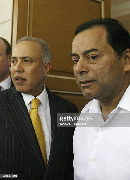 Chief Executive officer of Vodafone Arun Sarin along with the vice chairman of the ESSAR group Ravi Ruia leave a meeting in Mumbai 15 February 2007...