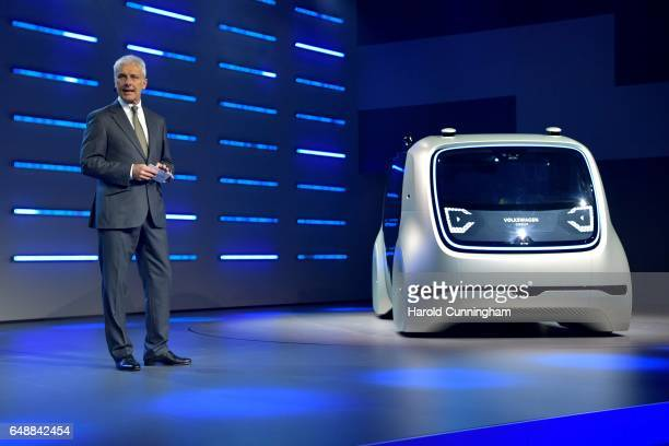 Chief Executive Officer of Volkswagen AG Matthias Mueller presents a Volkswagen AG 'Cedric' selfdriving automobile during the Volkswagen Group...