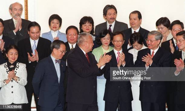 Chief Executive Tung Cheehwa applauses with his new team of principal ministers and permanent secretaries appointed under the new ministerial system...