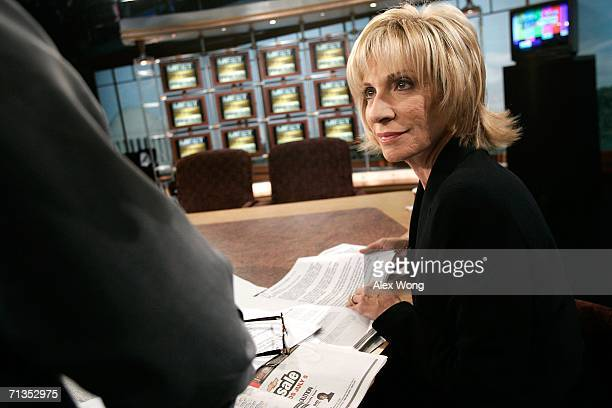 Chief Foreign Affairs Correspondent Andrea Mitchell discusses with a producer during a rehearsal of 'Meet the Press' at the NBC studios July 2 2006...