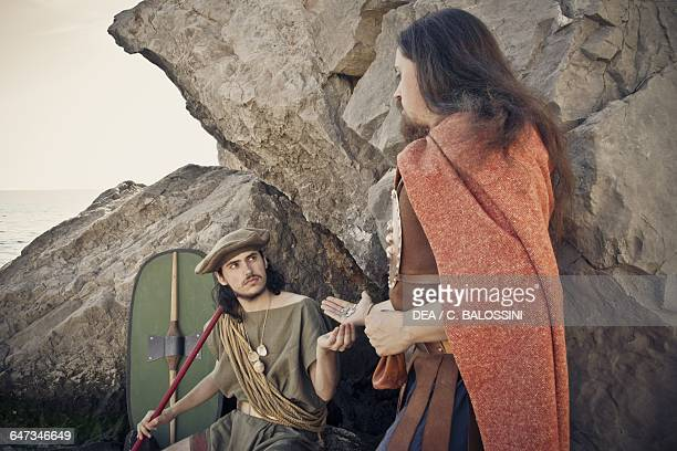 A chief giving coins to a warrior who has shown courage in battle Illyrian civilisation mid3rd century BC Historical reenactment
