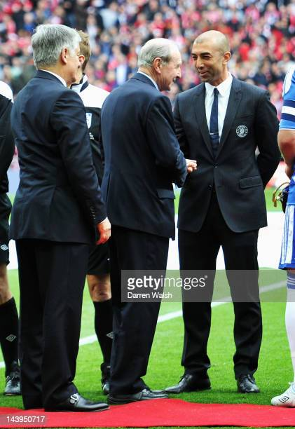 Chief guest Jimmy Armfield shakes hands with Roberto Di Matteo caretaker manager of Chelsea as the teams line up ahead of the FA Cup Final with...