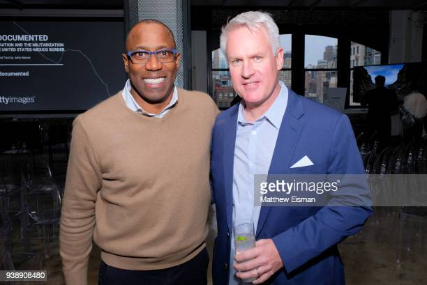 Chief Human Resources Officer Leander LeSure and Photographer John Moore attend the John Moore Undocumented Book Launch at Neuehouse on March 27 2018...