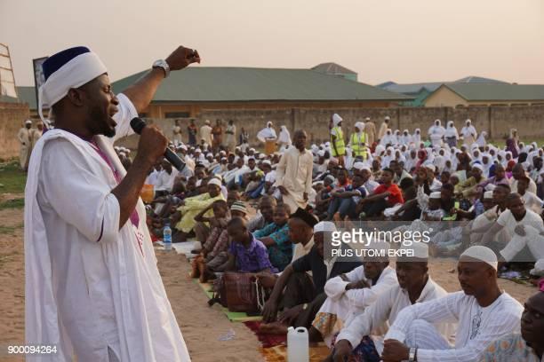 Chief Imam of Ibafo land and leader of Ya Lateef Islamic Society Rasaq Aliu Adeleye Okanlawon Esan prays for members during New Year's eve prayers at...