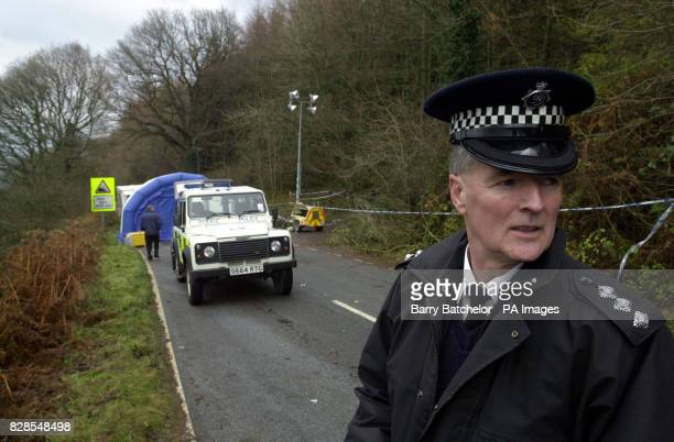 Chief Inspector John Oliver of Gwent Police closes the area along the road between Blaenavon and Abergavenny south Wales where the remains of a body...