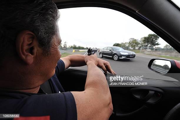 'TERRORISTES ET MANIFESTANTS LES DEUX CASSETETES DES CHAUFFEURS DE VIP' Chief instructor JeanYves Pezant prepares to shoot on a car with a gun loaded...