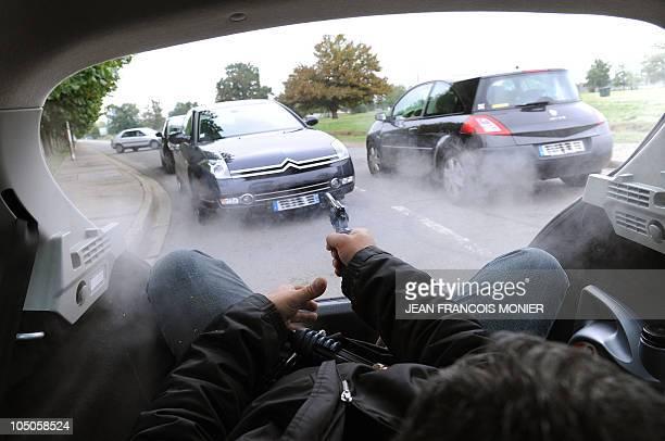 'TERRORISTES ET MANIFESTANTS LES DEUX CASSETETES DES CHAUFFEURS DE VIP' Chief instructor JeanYves Pezant shoots on a car during an attack exercise as...