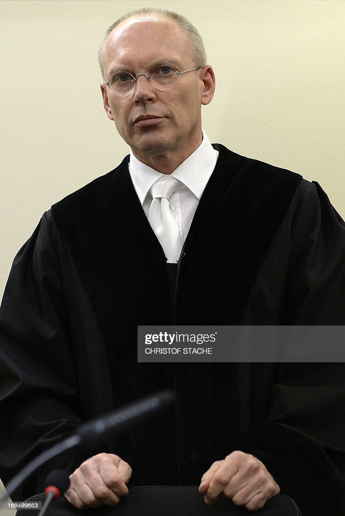 FILES - Chief judge Manfred Goetzl arrives at the regional courthouse in Munich on May 6, 2013 for the start of the trial of Beate Zschaepe. According to media reports on May 10, 2013, the court rejected a challenge on grounds of bias. Proceedings were delayed after motions by defence lawyers objecting to the trial's chief judge Manfred Goetzl. Beate Zschaepe is charged with complicity in the murders of eight ethnic Turks, a Greek immigrant and a German policewoman between 2000 and 2007 as a founding member and sole survivor of the far-right gang dubbed the National Socialist Underground (NSU).