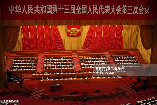 Chief Justice and President of the Supreme People's Court of China Zhou Qiang gives a speech during the Second Plenary Meeting of the National...