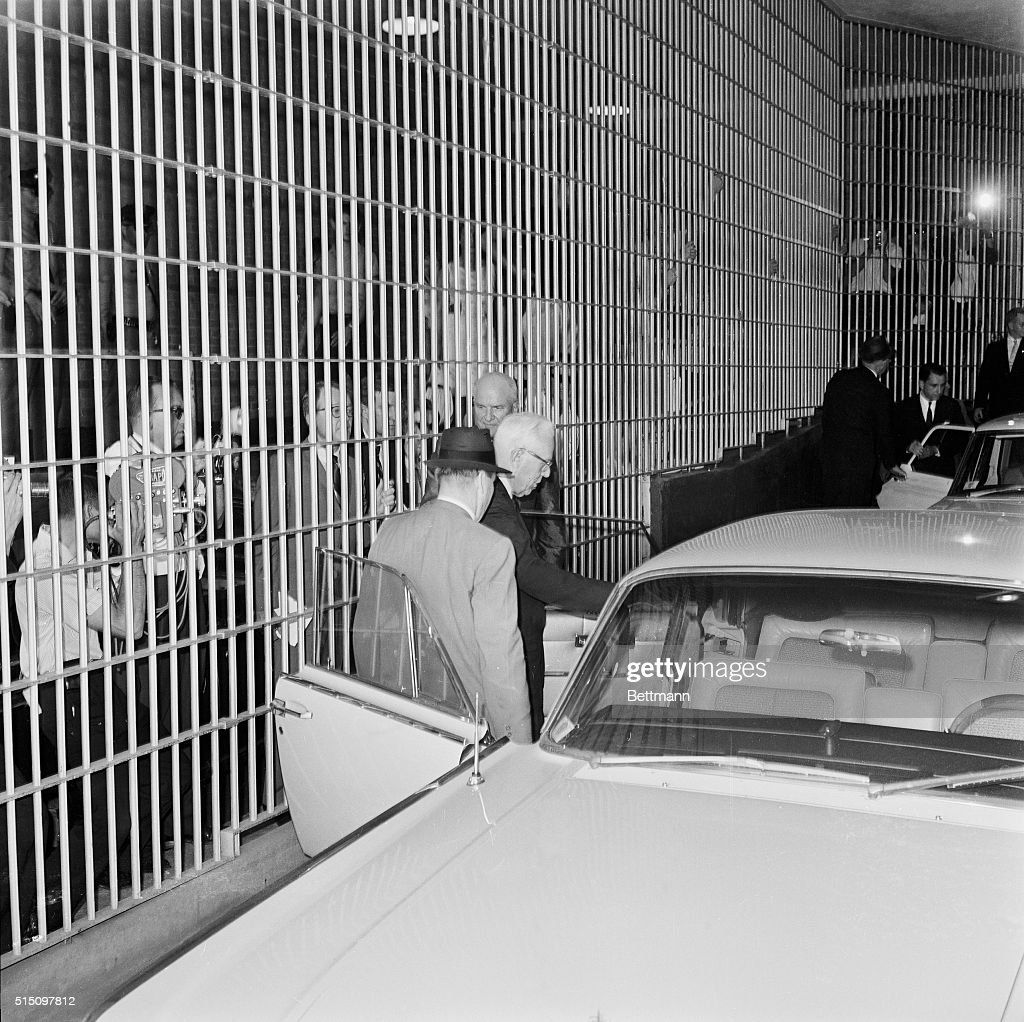 Chief Justice Earl Warren leaves Dallas County Jail after