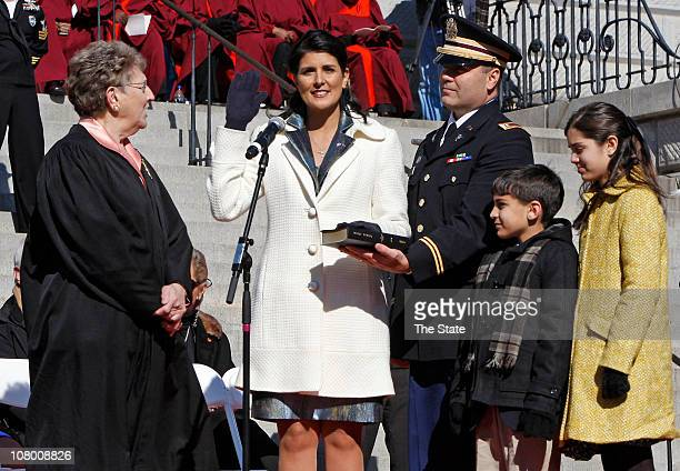 Chief Justice Jean Toal left administers the oath to incoming governor Nikki Haley during her inauguration on the Statehouse steps Wednesday January...