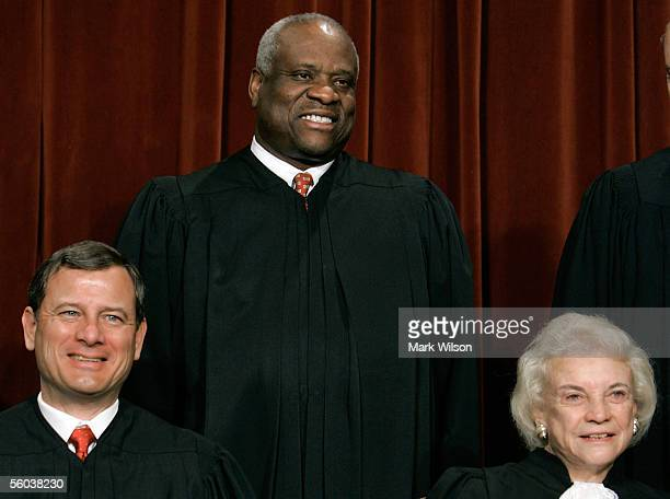 Chief Justice John G. Roberts Justice Clarence Thomas and Justice Sandra Day O'Connor pose for photographers at the U.S. Supreme Court October 31,...