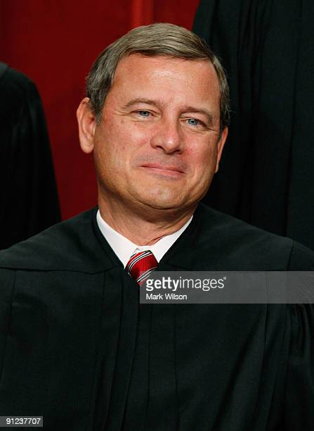 Chief Justice John G Roberts poses for a group photograph at the Supreme Court building on September 29 2009 in Washington DC The high court made a...