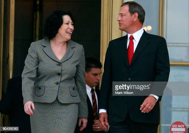 Chief Justice John Roberts and Associate Justice Sonia Sotomayor walk out of the US Supreme Court building after her investiture ceremony on...