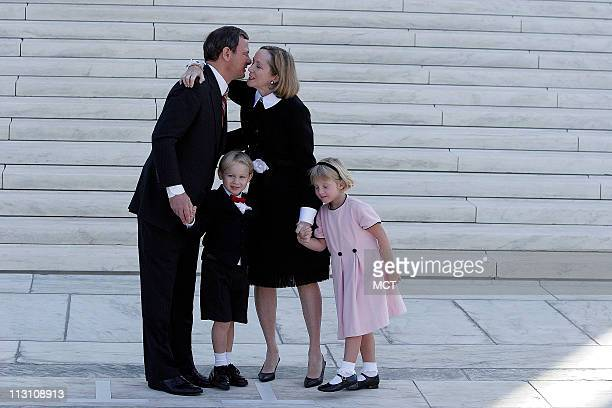 WASHINGTON DC US Chief Justice John Roberts kisses his wife Jane as son Jack and daughter Josie look on on the front steps of the Supreme Court after...