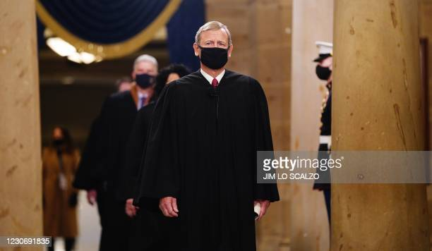 Chief Justice John Roberts leads the US Supreme Court Justices as they arrive before US president-elect Joe Biden is sworn in as the 46th US...