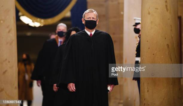 Chief Justice John Roberts leads the US Supreme Court Justices as they arrive in the Crypt of the US Capitol for President-elect Joe Biden's...