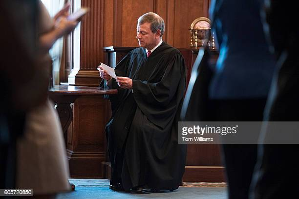 Chief Justice John Roberts signs the oath he administered to Librarian of Congress Carla Hayden, after a ceremony in the Great Hall of the Library of...