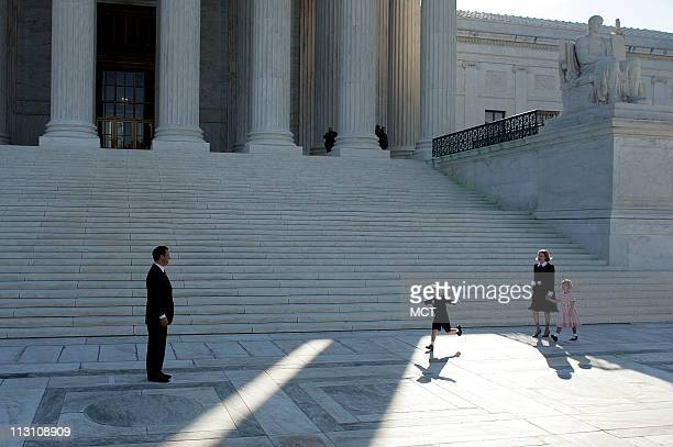 WASHINGTON DC Chief Justice John Roberts waits for a hug from his daughter Josie and son Jack on the front steps of the Supreme Court after his...