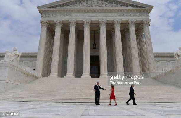 Chief Justice John Roberts walks away as Louise Gorsuch walks to greet her husband Associate Justice Neil M Gorsuch at the US Supreme Court following...
