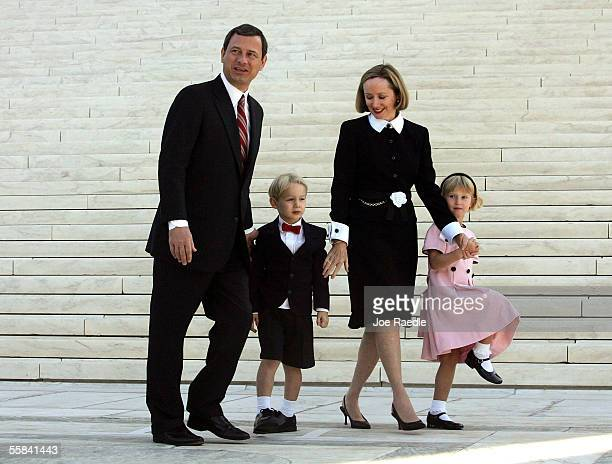 Chief Justice John Roberts walks with his wife Jane Roberts and their children Jack Roberts and Josie Roberts at the Supreme Court after he took the...
