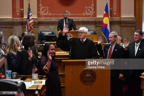 Chief Justice of the Colorado Supreme Court Nathan Coats, center, administered the oath of office to new Colorado senators during the opening day of...