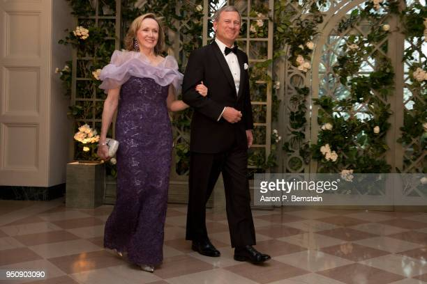 April 24: Chief Justice of the Supreme Court John Roberts and his wife Jane arrive at the White House for a state dinner April 24, 2018 in...