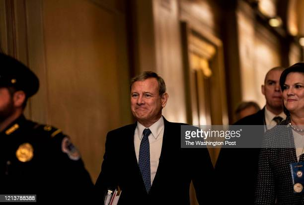 Chief Justice of the Supreme Court Justice John Roberts walks to the Senate floor for the Senate Impeachment Trial of President Donald Trump on...