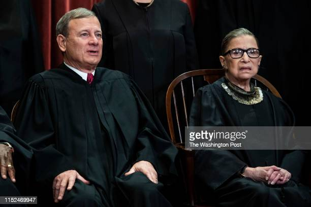 Chief Justice of the United States John G. Roberts, and Associate Justice Ruth Bader Ginsburg pose with other Justices of the United States Supreme...