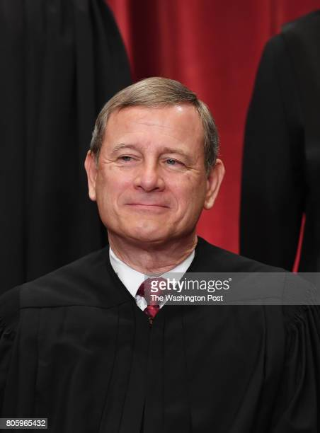Chief Justice of the United States John G. Roberts poses with other justices for a portrait in the east conference room of the building of the...