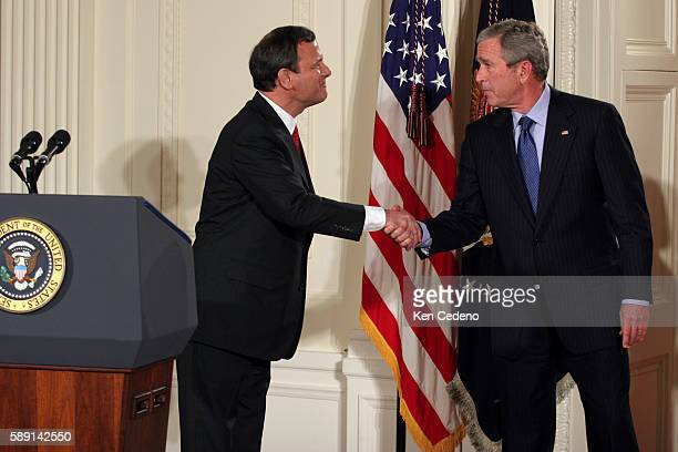 Chief Justice of the United States John Roberts shakes the hand of President George W Bush after Roberts was sworn in by Supreme Court Justice John...