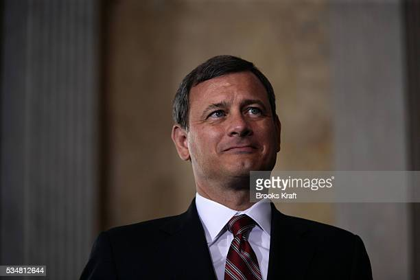 Chief Justice of the United States, John Roberts waits to administers the oath of office for the new Treasury Secretary Henry Paulson at the U.S....