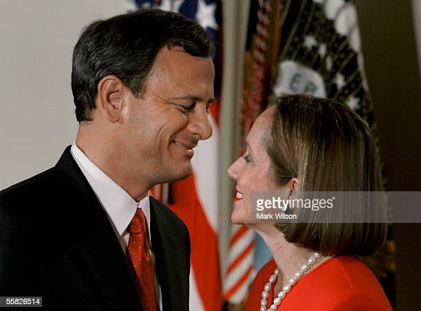 Chief Justice of the United States Supreme Court John Roberts hugs his wife Jane Roberts after being sworn during a ceremony in the East Room at the...