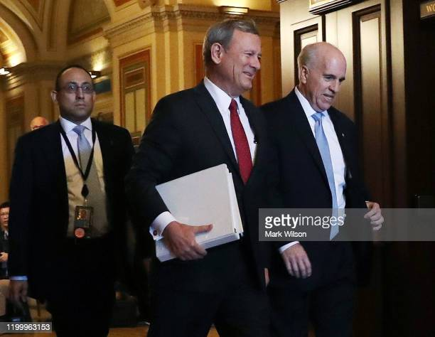 Chief Justice of The US Supreme Court John Roberts is escorted by Senate Seargent of Arms Michael C Stenger after he arrived at the US Capitol on...