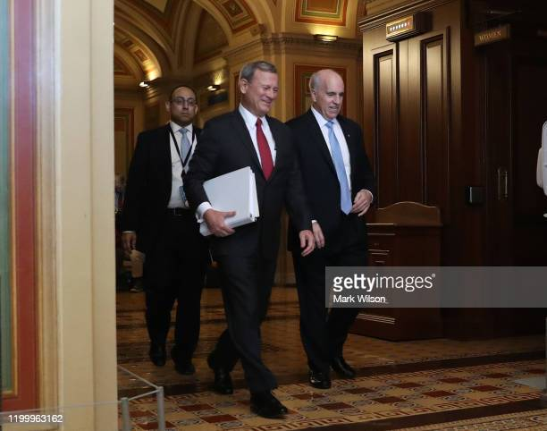 Chief Justice of The U.S. Supreme Court John Roberts is escorted by Senate Seargent of Arms, Michael C. Stenger after he arrived at the U.S. Capitol,...