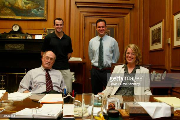 Chief Justice of the US Supreme Court William Rehnquist sits in his chambers with his staff of clerks at the Supreme Court building June 24 2002 in...