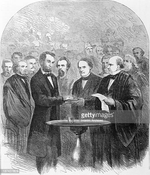 Chief Justice Salmon Chase administers the oath of office to Abraham Lincoln who holds his hand upon a bible during his second inauguration March...