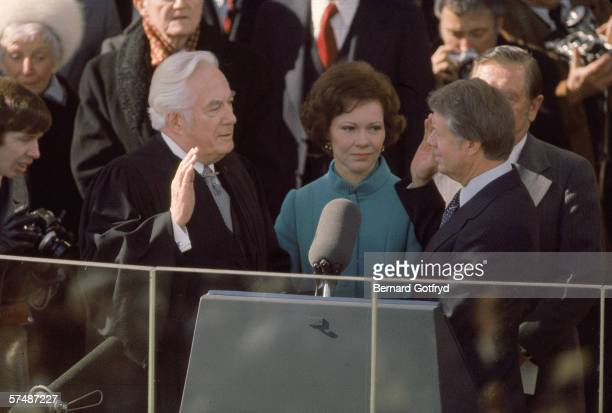 US Chief Justice Warren Burger swears in Jimmy Carter as the 39th President of the US at the US Capitol Washington DC January 20 1977 First Lady...