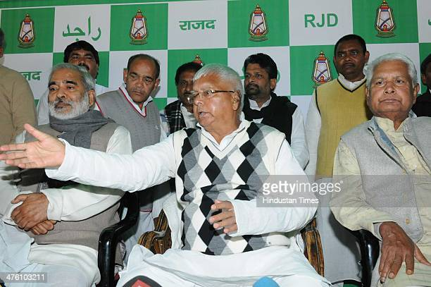 RJD chief Lalu Prasad addresses a press conference after Parliamentary board meeting in Patna on March 2 2014 in Patna India Lalu Prasad appealed to...