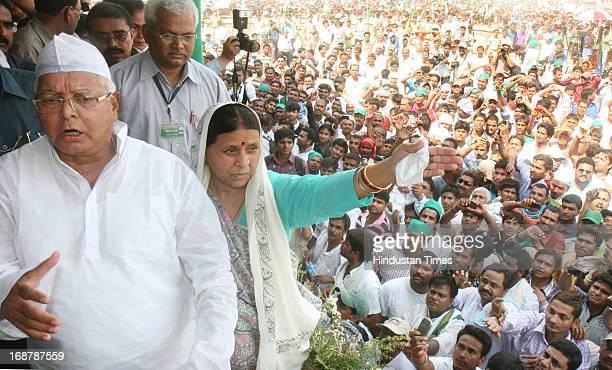 Chief Lalu Prasad Yadav and his wife Rabri Devi at Parivartan Rally at Gandhi Maidan on May 15 2013 in Patna India Addressing his first major rally...