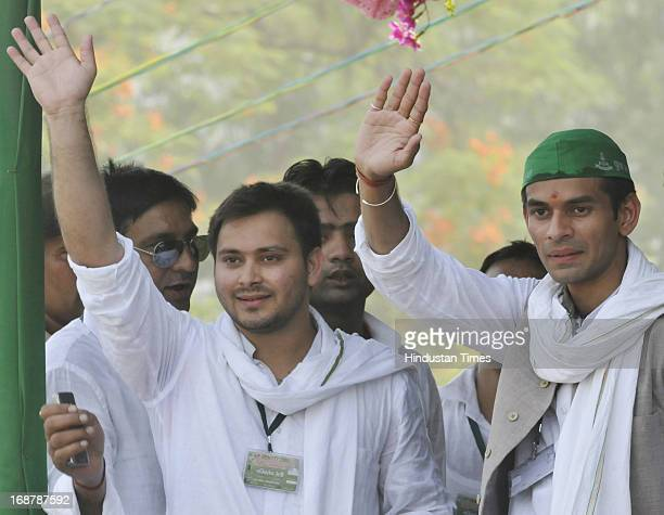 Chief Lalu Prasad Yadav and Rabri Devi's sons Tej Pratap and Tejashwi Yadav at Parivartan Rally at Gandhi Maidan on May 15 2013 in Patna India...