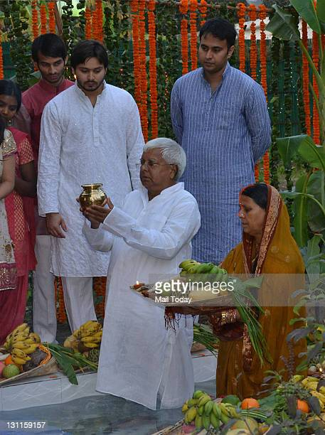 Chief Lalu Prasad Yadav and wife Rabri Devi doing Chhath puja at Lalu's official residence in New Delhi