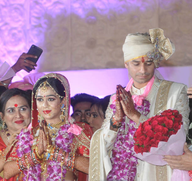 RJD chief Lalu Prasad`s elder son Tej Pratap Yadav and Aishwarya Rai during their wedding ceremony at Veterinary College Ground on May 12 2018 in...