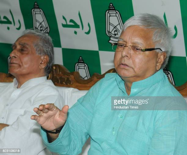 Chief Lalu Yadav speaking to media after Bihar Chief Minister Nitish Kumar submitted his resignation at Raj Bhawan on July 26 2017 in Patna India...