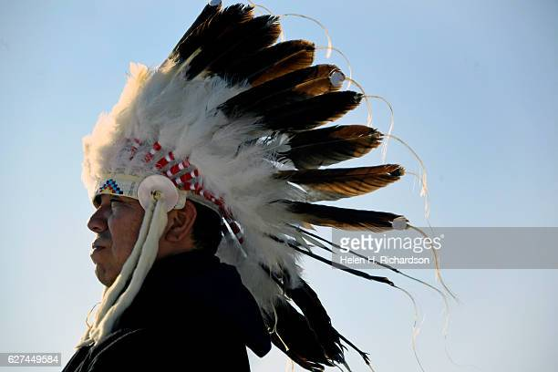 Chief Lance King of the Ogalala Lakota from Pine Ridge Reservation wears his Wa Pah Ha bonnet made from eagle feathers and rabbit skins at Oceti...