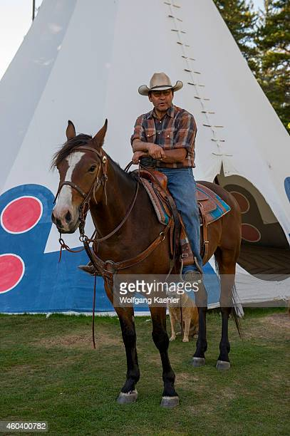 Chief Little Dog a Blackfoot Native American on his horse in front of a tipi at Glacier Park Lodge which is located just outside the boundaries of...
